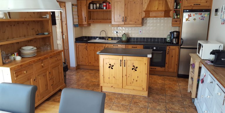 Kitchen with additional freestanding furniture