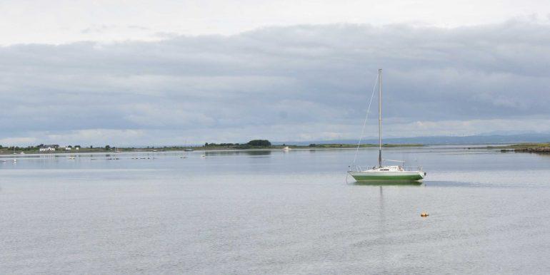 Boat-on-Tarrea-bay-calm-July-2017